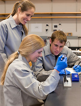Colgate biology professor Krista Ingram works with students in her lab.