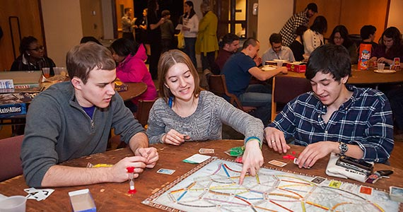Students playing board games at an event held by The Game's Afoot
