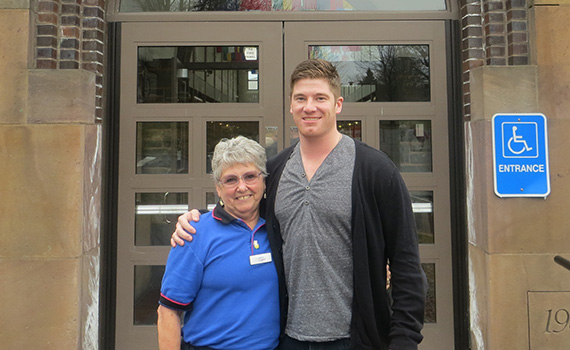 Longtime Frank Dining Hall cashier Jean Brooks and Christian Long '13, a former member of the hockey team