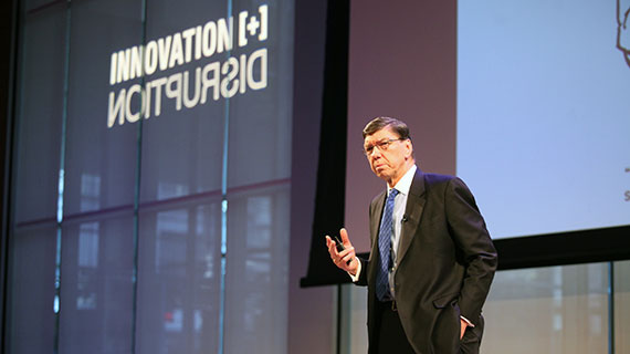 Clayton Christensen speaks Monday at the Innovation + Disruption symposium. (Photo by Lorenzo Ciniglio)