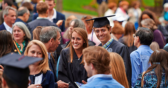 Graduates enjoy time with friends and families. (Photo by Andy Daddio)