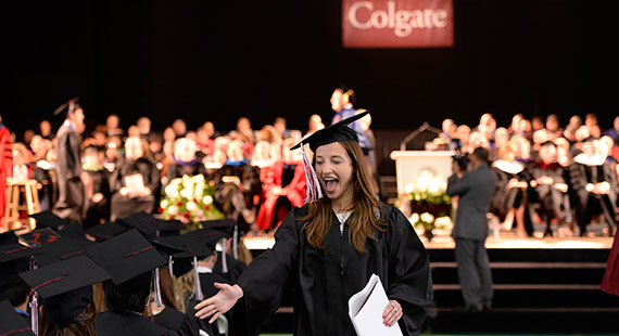 A graduate returns to her seat after receiving her diploma. (Photo by Andy Daddio)