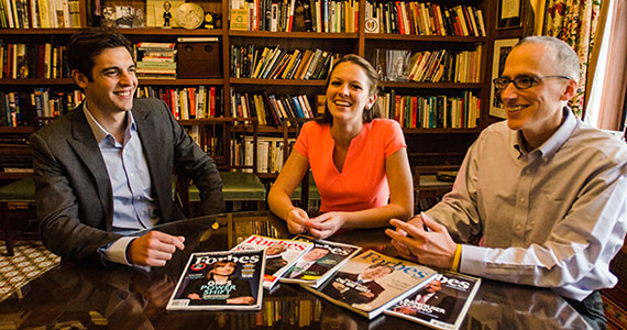 Steve Bertoni '02, Natalie Sportelli '15, and Kurt Badenhausen '94 (left to right) in the Forbes library. (Photo by Zach D Roberts)