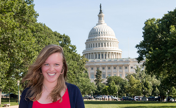 Annie Hoefler '15 in front of her workplace, the U.S. Senate.