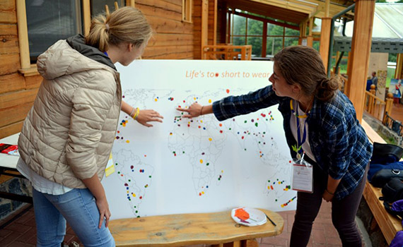 Ieva Steponaviciute '17 (left) maps strategy in a photo from the MERAKI Facebook page.