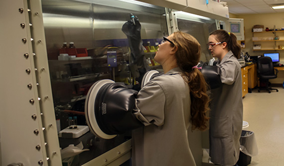 Melissa Barnard '15 and Tia Cervarich '16 work in the lab of Professor Anthony Chianese.