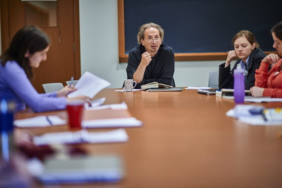 Peter Balakian is seated a table teaching an English class in Lathrop Hall