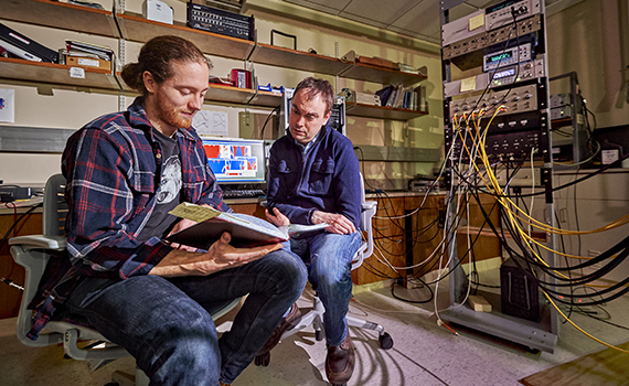 Matt LeGro '15 and Professor Ken Segall are using helium in their research studying the behavior of Josephson junctions (small electrical circuits) to see if they can model neuron behaviors in the brain. Photo by Andrew Daddio
