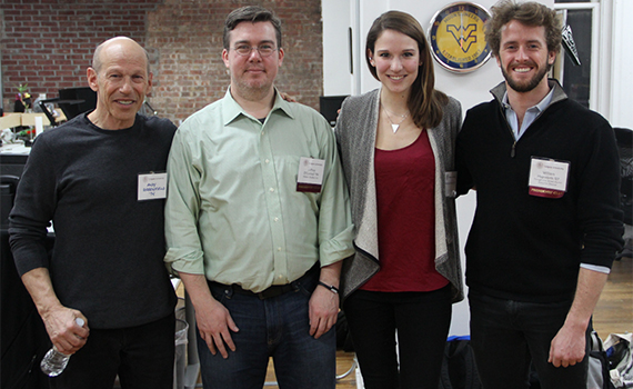(Left to right) Thought Into Action founder Andy Greenfield '74, P'12, digital technology network volunteer Jeff O'Connell '94, Amanda Brown '15, and Thought Into Action Executive Director Wills Hapworth '07 during Colgate's Hackathon on Saturday, March 14
