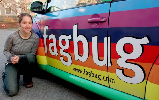 "LGBTQ advocate Erin Davies poses with her ""fagbug"" car."