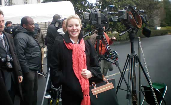 Emily Bradley '10 stands with the press corps outside the White House