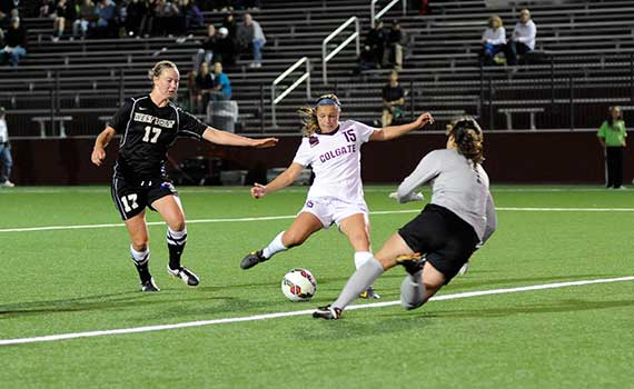 Lexi Panepinto '16 kicking the soccer ball in a game vs. West Point