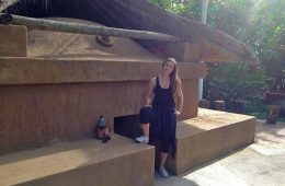 Hannah Robinson '11 stands outside a Mayan steam bath in Guatemala.