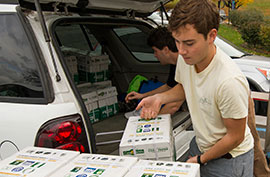 Ryan Smith, founder of EcoCampus LLC, unloading paper at Case Library