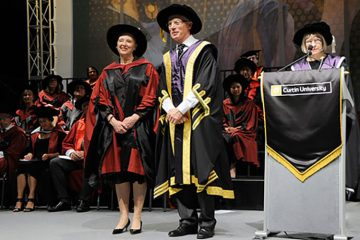 Professor Ellen Kraly stands on the commencement stage with Curtin University Chancellor Mr. Colin Beckett and Vice-Chancellor Professor Deborah Terry