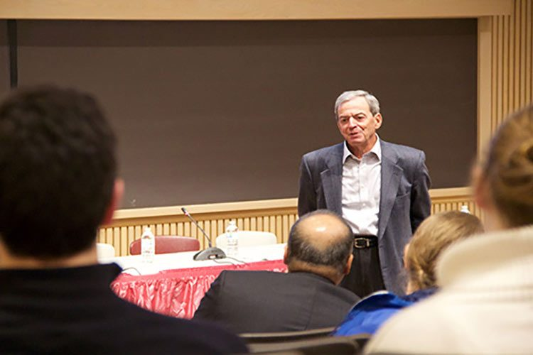 Wolk Medical Conference attendees ask a question of Michael J. Wolk '60.