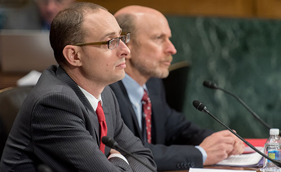 Professor Chad Sparber sits at a table while giving testimony to the Senate Subcommittee on Immigration and the National Interest