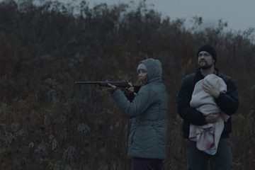 a still from the movie, this shot depicts two actors in a dark field