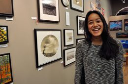 Colgate student Ranissa Adityavarman '16 smiles in a photo at an art gallery.