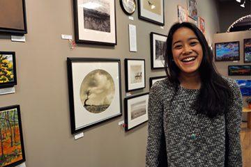 Colgate student Ranissa Adityavarman '16 smiles in a photo at an art gallery.