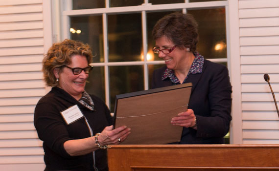 Professor Rhonda Levine and interim dean of the faculty Constance Harsh stand together at a podium holding the Jerome Balmuth Award