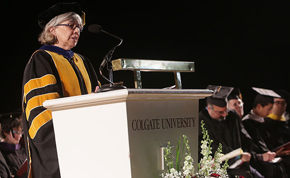 Interim President Jill Harsin stands at the podium in Sanford Field House during Commencement 2016 (Photo by Gerard Gaskin)