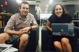 Erica Pais '17 sitting with a laptop at Chicory headquarters with founder Joey Petracca '13