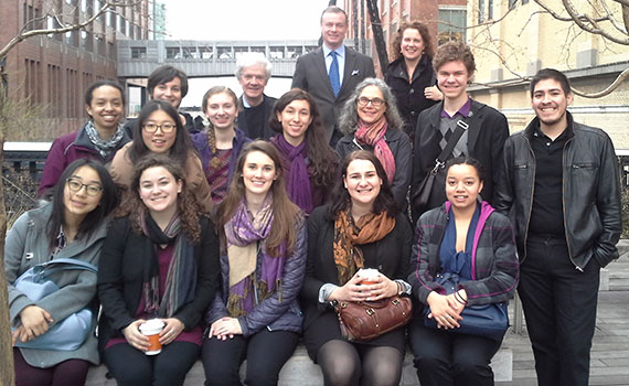 group portrait of students, faculty, and alumni standing on the Highline in New York City