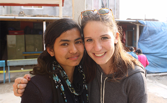 Tenth-grade student Radha and Amanda Brown '15 pose for a photo at Life Vision Academy in Nepal.