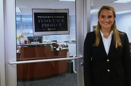 Student Madison Bailey standing in front of the Pennsylvania Innocence Project headquarters.