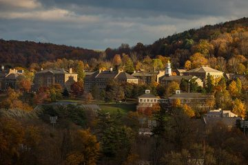 A scenic view of Colgate's campus and hillside from a distant with dramatic lighting