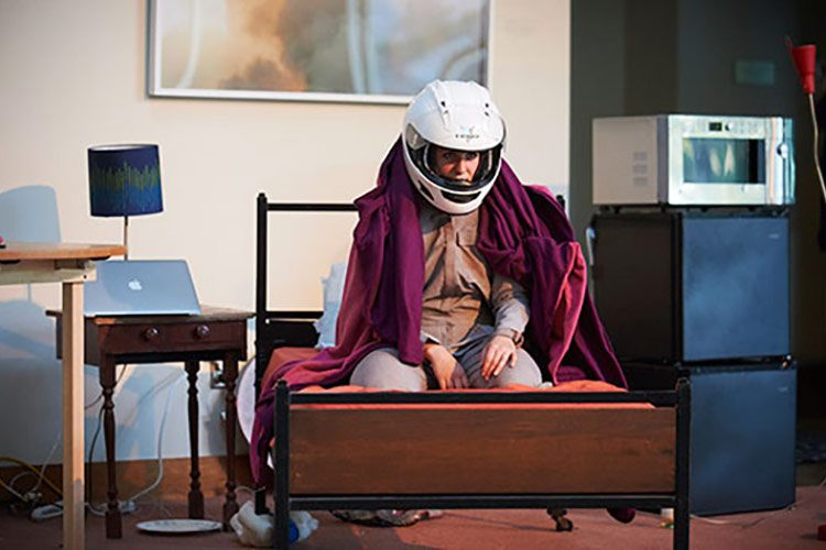 Dani Solomon, performing in One Way Red, a solo show that followed a young woman's one-way journey to Mars.