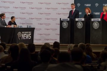Three candidates for the 22nd Congressional District seat standing at podiums at the debate in the Memorial Chapel at Colgate University