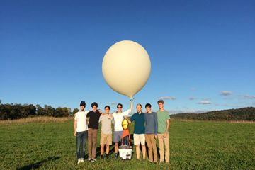 The Engineering Club members prepare to launch their weather balloon.