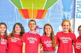 Students in matching red Colgate Computer Science t-shirts at the conference