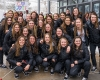 A team picture of the women's ice hockey team as before they board the team bus, bound for the Frozen Four