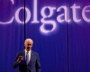 "Joseph ""Joe"" Biden Jr. speaks in front of a Colgate backdrop"