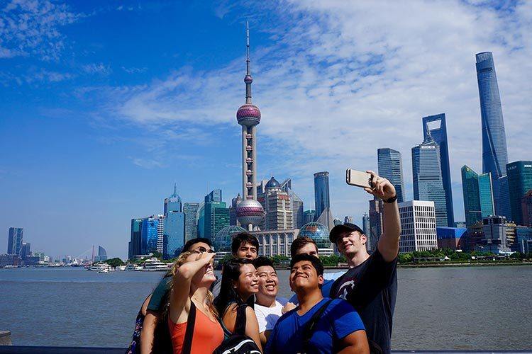 Colgate students take selfie in front of Beijing skyline