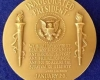Presidential Medals of Honor for Citizens often feature the Torch of Freedom