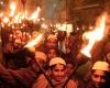 A torchlight procession in the dark
