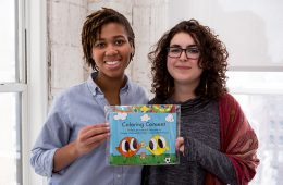 ehdeiah Mixon '18 and Hannah Shaheen O'Malley '17 hold up a publication they produced for their new startup, UNRAVEL