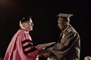 Student shaking hands with president at Commencement