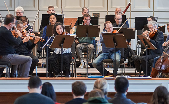 Orpheus Chamber Orchestra plays onstage in the Colgate Memorial Chapel