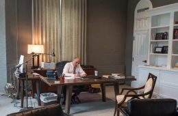 President Brian W. Casey works at the desk in his office