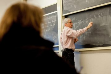 Professor Schult teaches a class in mathematics.