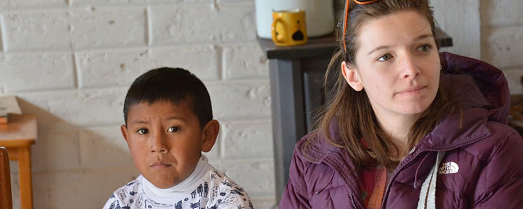Caroline Correia '17 sits next to a student from the preschool Comunidad Educativa Tamujé Iwigara in Creel, Chihuahua