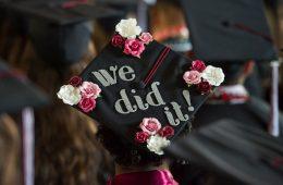 "back of graduation cap reading ""we did it!"""