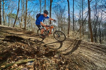A person riding their bike on the trails