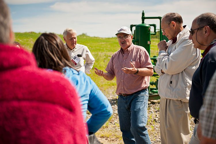 Bruce W. Selleck, Thomas A. Bartlett Chair and Professor of Geology, tours a local natural gas well with alumni during Reunion 2011.