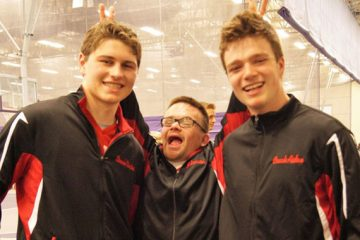 Aidan Gaertner '20 and others pose for a photo at the Special Olympics of Minnesota